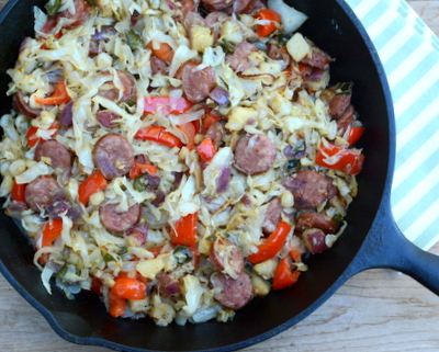 Sausage & Cabbage Skillet ♥ AVeggieVenture.com, supper in a flash, a big ol' skillet of rustic and homey sausage, potato and cabbage that turns quite sweet and succulent. Low carb, even with potatoes; even lower carb with turnip. Gluten free so long as sausage is gluten free. Weight Watchers Friendly.