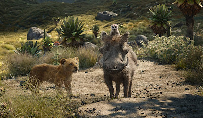 "Movie still for the 2019 film ""The Lion King"" where Timon (Billy Eichner) and Pumbaa (Seth Rogen) walk with a young Simba throughout the savanna"