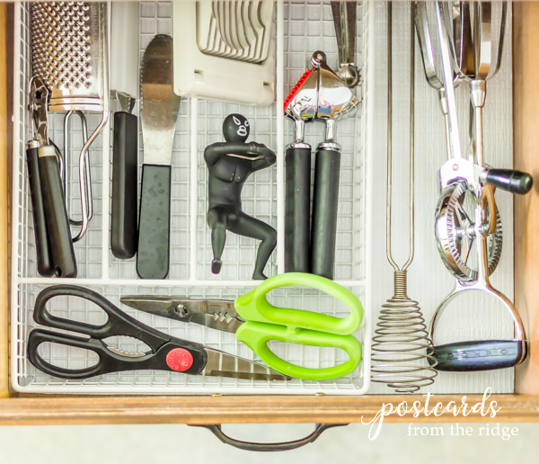 kitchen gadget drawer with white wire tray and Duck Brand Smooth Top EasyLiner
