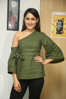 Pragya Jaiswal in a single Sleeves Off Shoulder Green Top Black Leggings promoting JJN Movie at Radio City 10.08.2017 083.JPG
