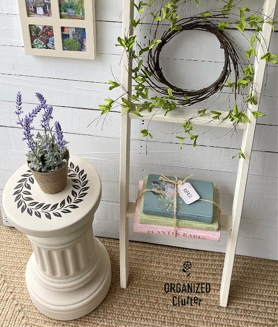 Photo of terracotta fluted column pedestal staged with potted lavender and a ladder