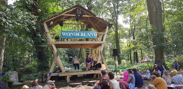 Wonderland Stage amid forest at Just So Festival with 2 women performing