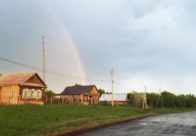 радуга над деревней после дождя