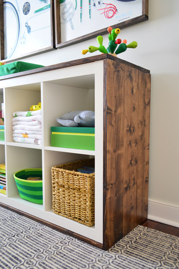 Ikea hack for Kallax shelving with rustic wood for changing table in nursery - found on Hello Lovely Studio