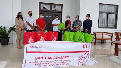 Alfamidi Salurkan Bantuan Bagi Warga Terdampak PPKM di Kota Bitung