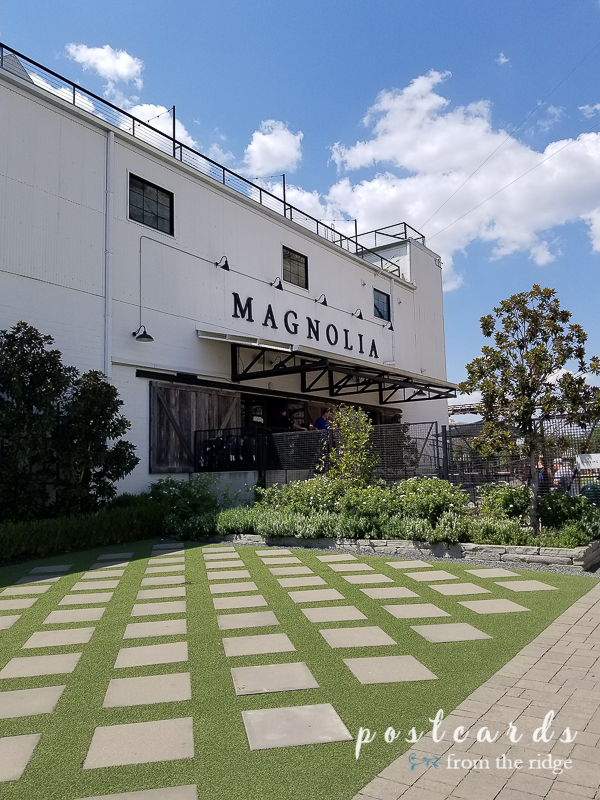magnolia market storefront and lawn with square stones
