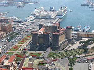 The Castel Nuovo in Naples, with the port, one of the  largest in the Mediterranean, in the background