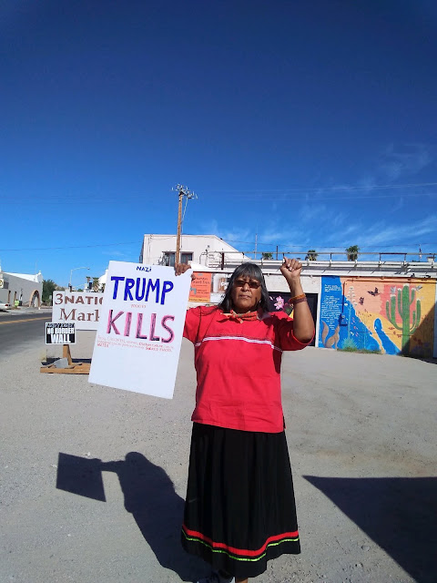 Ofelia Rivas protesting Trump's border wall