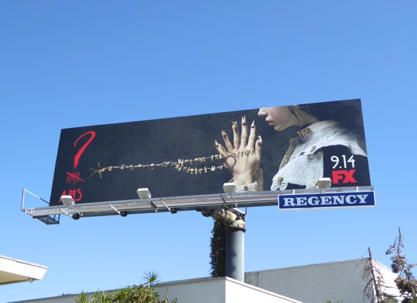 AHS ?6 tooth rosary necklace billboard