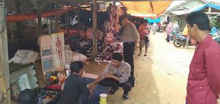 Sat Sabhara Polsek Bengkunat Rutin Melaksanakan Pengamanan di Pasar