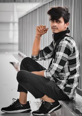 Stylish Sitting Photo Pose For Boys In Balcony