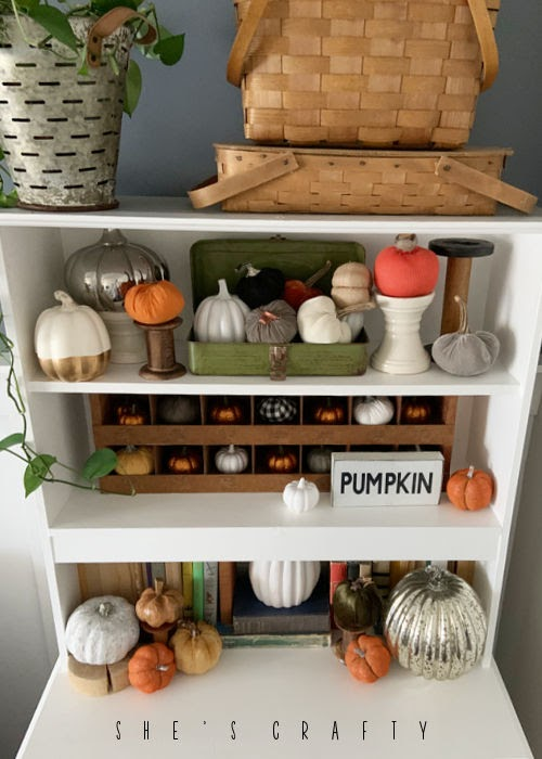 Fall Vignette in a White Hutch with faux pumpkins.