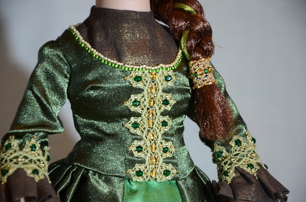 Handmade embroidery and beading on doll's dress.