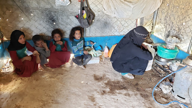 A displaced family in their tent in al-Sowida camp for internally displaced people in Marib governorate, north Yemen, February 2020. The family had been displaced twice, the second time after fleeing to Marib to escape renewed fighting near the capital, Sanaa. © 2020 Ali Owidha