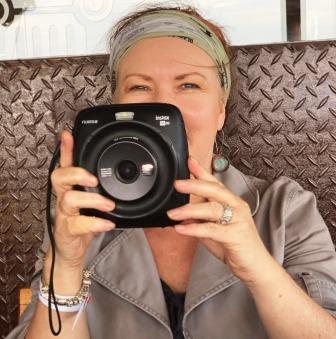 Black Instax Square SQ20 in hands of Karen du Toit
