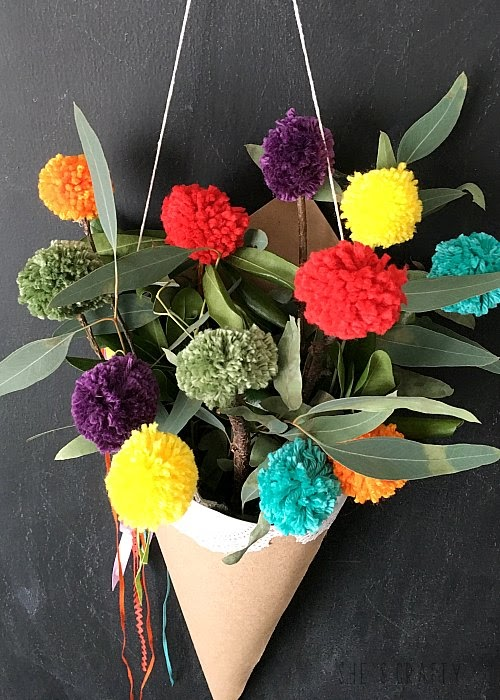 Freshen your home for Spring with a paper cone holder full of Rainbow Pom Pom sticks