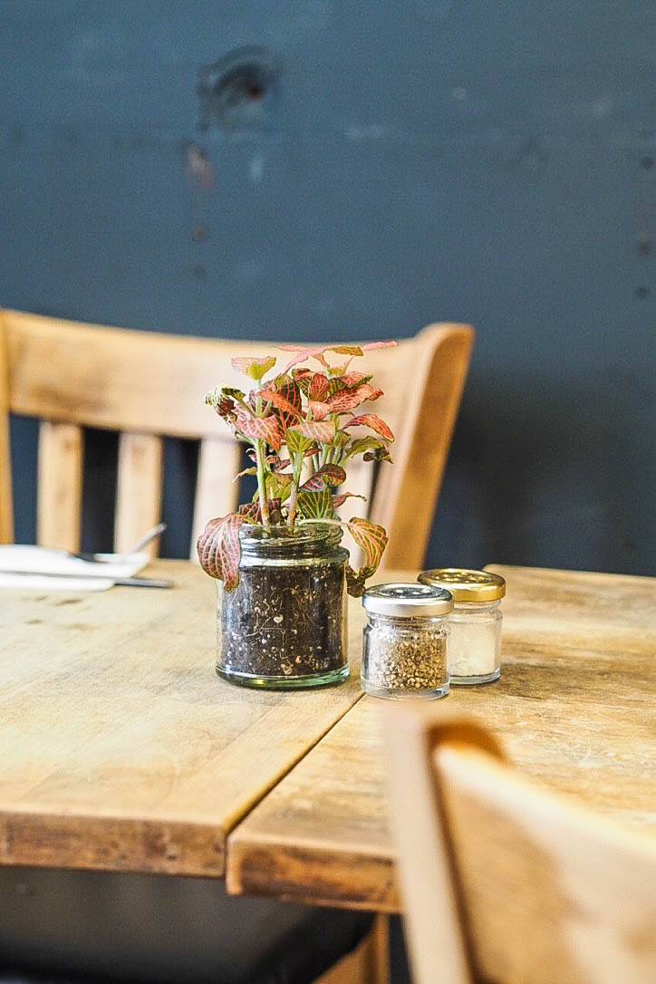 Jar Of Flowers On Wooden Table ...