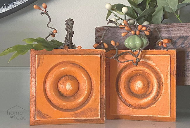 two pumpkins distressed with cinnamon