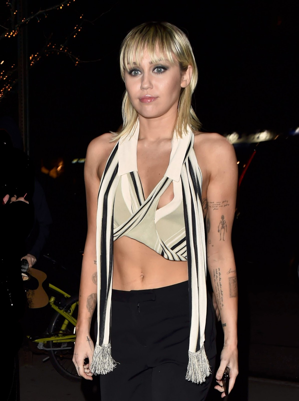 Miley Cyrus suffers WARDROBE MALFUNCTION in busty wrap crop top as she leaves Marc Jacobs NYFW show after electrifying runway appearance