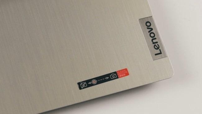 Fingerprints on the smooth matte finish of Lenovo IdeaPad Slim 3i laptop.