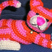 http://www.ravelry.com/patterns/library/cat--ball-tissue-cover