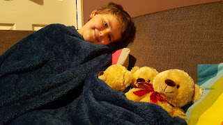 Dan Jon Jr with his three bears and blanket