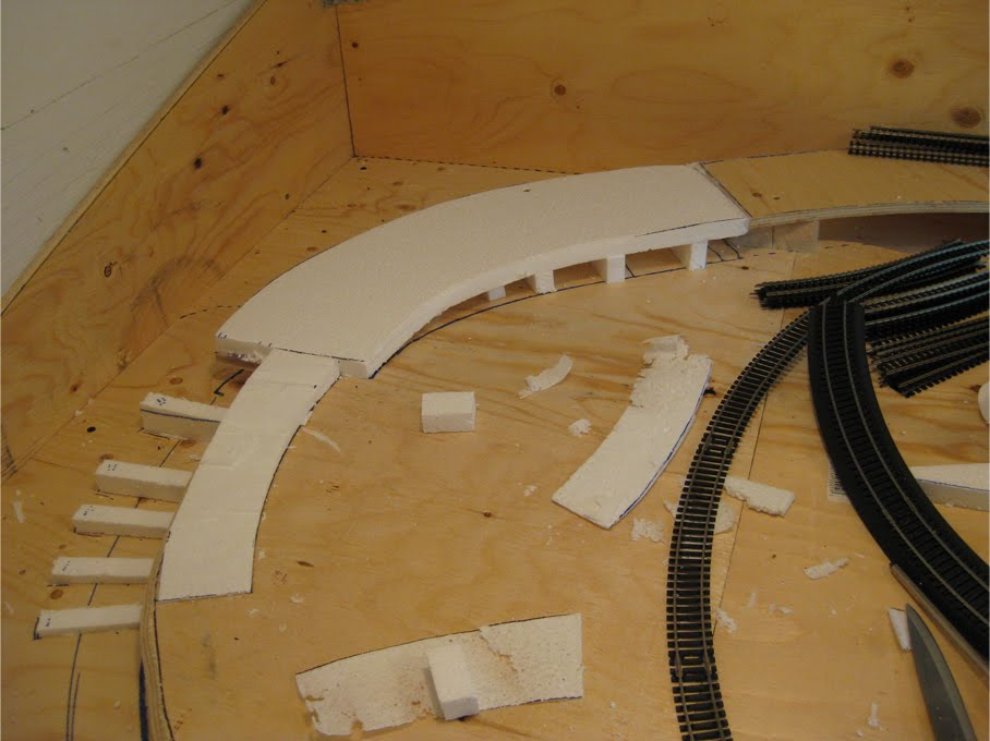 A track riser made of expanded foam leading from one elevation of benchwork to another