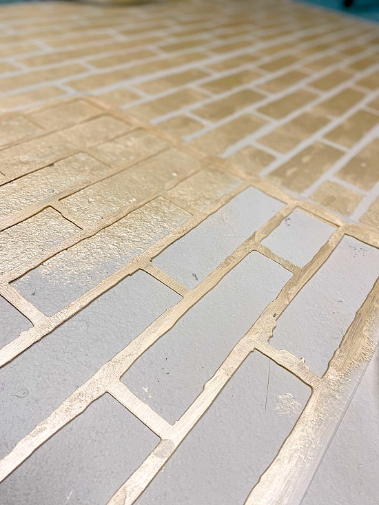stenciled metallic bricks with a stencil