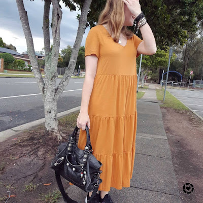 awayfromtheblue Instagram | Kmart short sleeve tiered jersey midi dress in amber with black accessories balenciaga part time bag sneakers