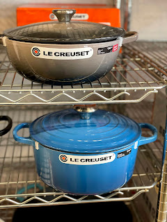 Light Blue Le Creuset Dutch Oven on a metal shelf