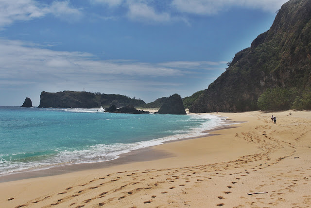 Frolicking in the fine sandy beach of Cibang Cove in Calayan Island