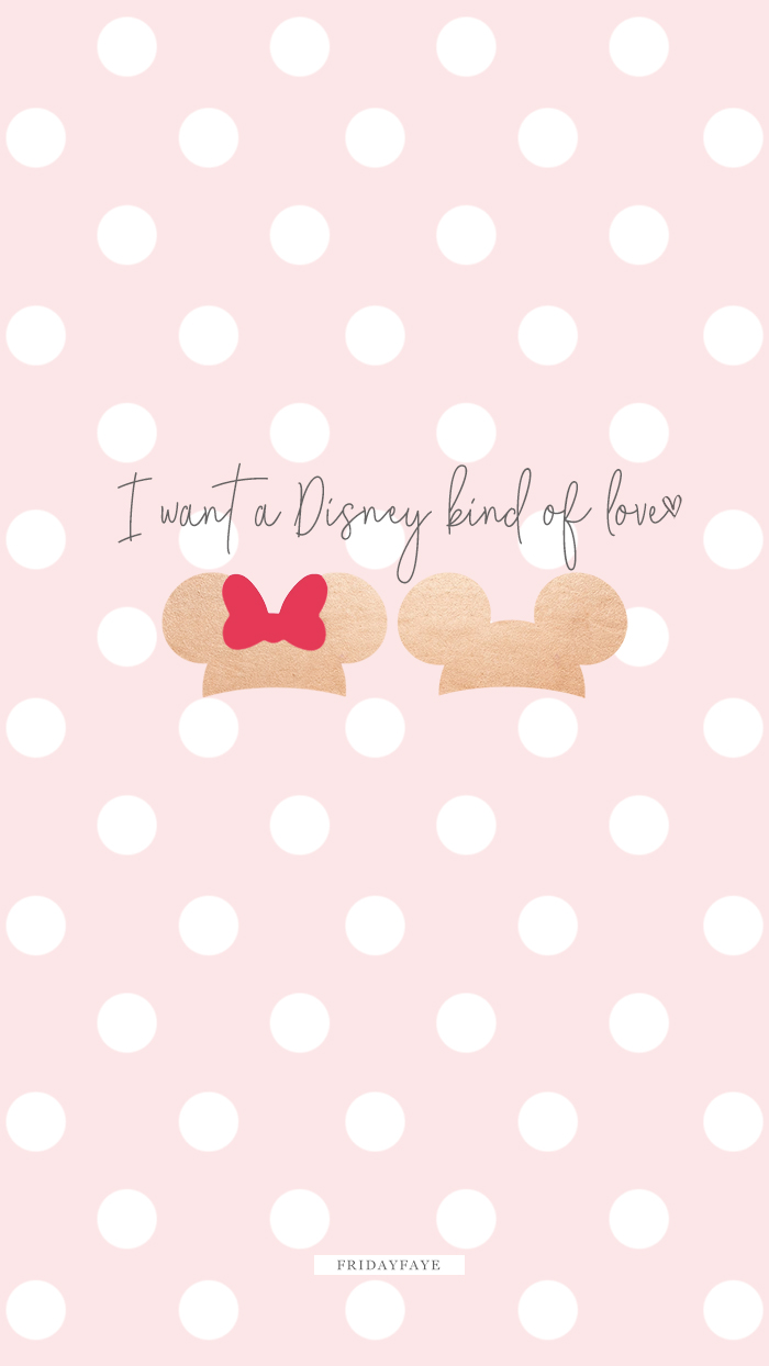 "Text on pink background ""I want a Disney kind of love"" with Mickey and Minnie mouse ears"
