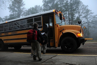 Image of children entering the school bus to back to school