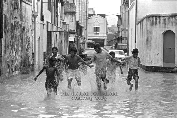 Having fun in the flood in Singapore in 1974