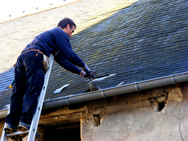 Repairing a slate roof, Indre et Loire, France. Photo by Loire Valley Time Travel.