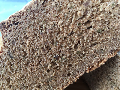 Crumb shot of a dense looking wholemeal bread