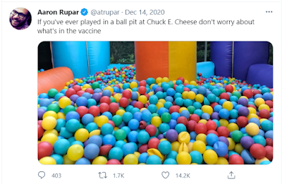 Picture of a ball pit filled with blue, red, yellow, and green plastic balls. The words of above the photo read: If you've ever played in a ball pit at Chuck E. Cheese don't worry about what's in the vaccine.