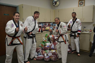 Martial arts students participating in community service after martial arts lessons