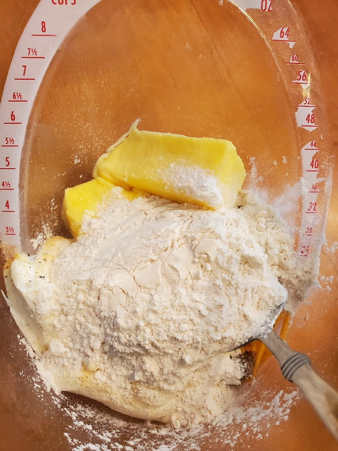 this is the flour and butter for making biscuits in an OXO large measuring cup