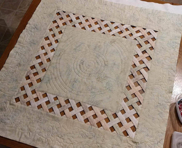 Open weave batik lattice quilt with prairie points