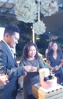 Sukri Kadola, Bloem and Ivy Tan, FAST, cut a cake during the anniversary celebration.