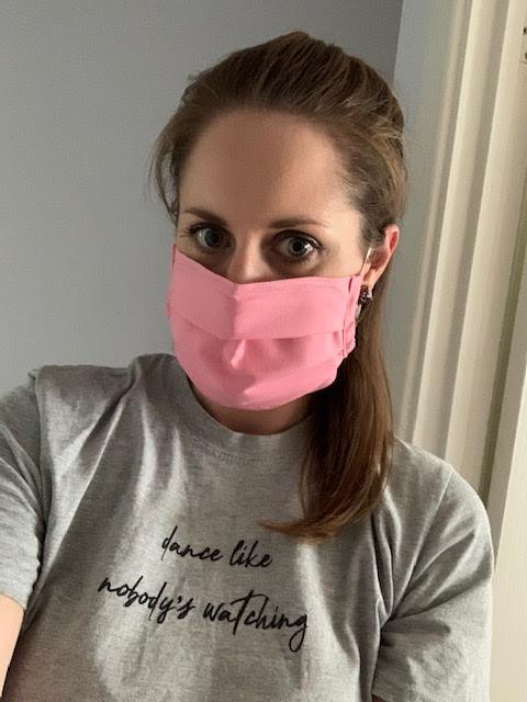 Woman wearing pink fabric face mask