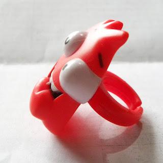 Red plastic monster ring from Greggs