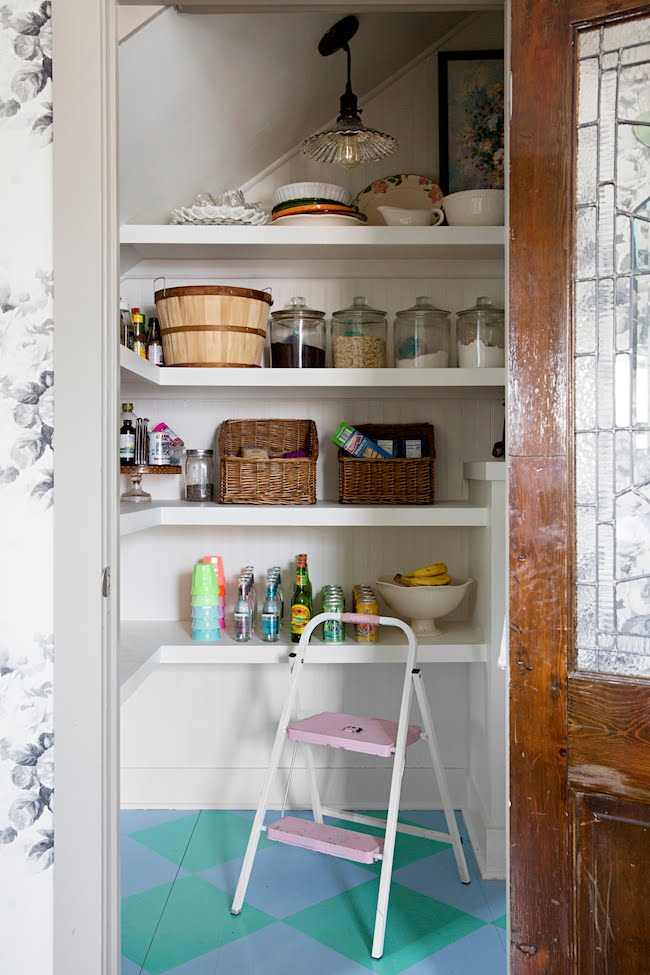 pantry with painted checkerboard floor