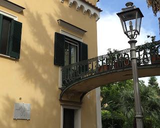 The plaque commemorating Ibsen's stay is just next to the hotel's elegant bridge across Via Vittorio Veneto