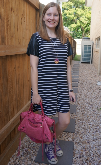 black and white striped tee dress with contrast sleeves and pink and purple accessories high tops balenciaga city | away from blue