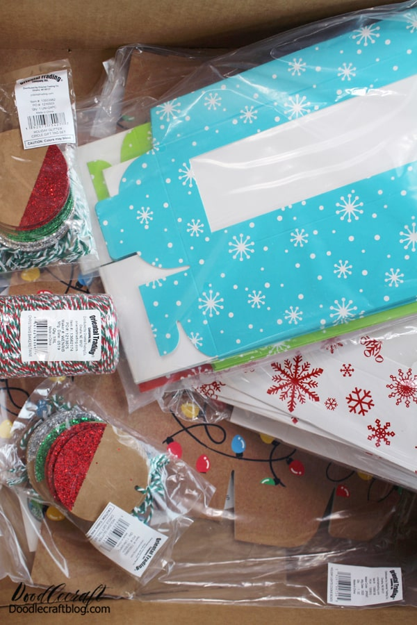 "Holiday Baked Goods Boxes Kit This Kit Includes: • 1 Cotton Christmas Baker's Twine (328 ft.)  • 12 Cardstock Holiday Cookie Boxes (Each with a cellophane window. 8"" x 3"" x 3 1/4"" Simple assembly required.)  • 48 Paper Glitter Kraft Paper Gift Tags (2 1/2"")  • 12 Coated Cardstock Holiday Lights Cookie Boxes (Each with a cellophane window. 7"" x 3"" x 2"" Simple assembly required.)  • 12 Cardstock Red & White Snowflake Cookie Boxes (Each with a cellophane window. 7"" x 3 1/4"" x 2"" Simple assembly required.)"