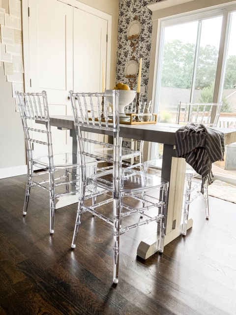 acrylic chairs in a dining room