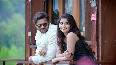 Tej I Love You (2018) is an Indian Telugu romantic film directed by A. Karunakaran in 2018. The film is produced by K.S. Rama Rao under the creative Commercials banner. The film is starred by Sai Dharam Tej and Anupama Parameswaran in the lead roles and Jayaprakash, Pavitra Lokesh, Anish Kuruvilla, Surekha Vani, Prudhvi Raj and others in some important roles. But here, the roles of Sai Dharam Tej and Anupama Parameswaran are very important.   Sai Dharam Tej and Anupama Parameswaran in Tej I Love You (2018) Movie    What a romantic drama film! I have watched several times this movie for its outstanding romance between Tej and Nandini. Here Sai Dharam Tej plays role as Tej. Not only in this movie but also in other acted movies, he plays his role as named Tej. I think it would be very easy to memorize the character in the same name. But the same names in different movies will help to misunderstand the audiences. However, Anupama, here plays her role as Nandini, a beautiful, talented young girl. Anyone will propose any time because they won't miss the moment. Bu in the movie, Tej is a person of some different kind character. He also falls in love at the first sight in the running train. But Nandini (Anupama) has bluffed him disguising her as blind girl. Here, a kind of sympathy is created in his mind. But when he saw her walking fast towards him without glass, he understood her bluffing. Then what would happen? In films, actually at first, quarrelling, and no tolerance to each other etc will happen. In this movie, these things also happened. But romance comes when they think their relationship is strong and trustworthy. But all are ended when Nandini conduces an accident. She loses her memory but for an indefinite duration. She can memorize her father, her mother but her mother is died which she cannot remember. Why does she come in India from London? She cannot remember. So, Tej thinks all are ended as she has forgotten their former relationship and he do not know that whether she accepted his love or not. Crazy Boys Music Troops of India is Tej's band group. Nandini loved music from childhood. So, she joined in their group. Tej's friends tried her many to memorize her love but in vain. Nandini came to know from coach Murthy that whom she came to find in India is Tej. Actually, Tej rescued her mother in childhood from two goons and one is killed by him. He had to spend 7 years in jail. He has to stay far away from his aunty and uncle for protecting his pregnant cousin getting married to her lover. Nandini's mother wanted to give property to Tej for rescuing her life. She knew that he had to spend seven years in jail for protecting her life. But Nandini's father has always wanted to keep the property to him. The documents of the property, Tej did not take. In the last scene when Nandini and her father were at the airport, Nandini came to know that she proposed Tej with giving a letter and latter a digital pen in which she recorded 'Tej I Love You'. Nandini returned to Tej.   Sai Dharam Tej and Anupama Parameswaran in Tej I Love You (2018) Movie    It is a romantic drama film for the audiences to get entertainment. I mean Sai Dharam Tej's most of the movies are of action genre. But it is a romantic and attractive drama film, a decent film. All members of a joint family can watch it without any hesitation because it has no indecency. I like the film in this perspective that its story is a creative work. I have watched over thousands world cinemas. But unique story is rare in those movies. But it is a unique story. Not only it but also most of the south Indian movies are unique in story or styles. When I differentiate these south Indian movies with Bangladeshi movies, I don't find any uniqueness in Bangladeshi films. Present movies of Bangladesh are not suitable for watching with joint family members and there is no unique story in these films. Sometimes, the directors copy posters, sometimes story, sometimes several scenes from other movies. I appreciate Sai Dharam Tej and Anupama Parameswaran's performance.    Sai Dharam Tej and Anupama Parameswaran in Tej I Love You (2018) Movie    It is natural, sometimes romantic, sometimes dramatic acting and natural dialogues. No action, only romance is here in the movie. What is the purpose of film? Entertainment, entertainment and entertainment? No, never, not only entertainment but also it may have education, knowledge, news. A great factor is news. You are an audience. You watched a film and you may have news that means knowledge that you did not know before. I have got three kinds of news in this film compelling a girl to smoke, taking sign in a blank document to use personal purpose and recording words into a pen. A person can know a matter but others may not and others can know an issue but a person may not.  Watch the full movie 'Tej I Love You' (2018) here...