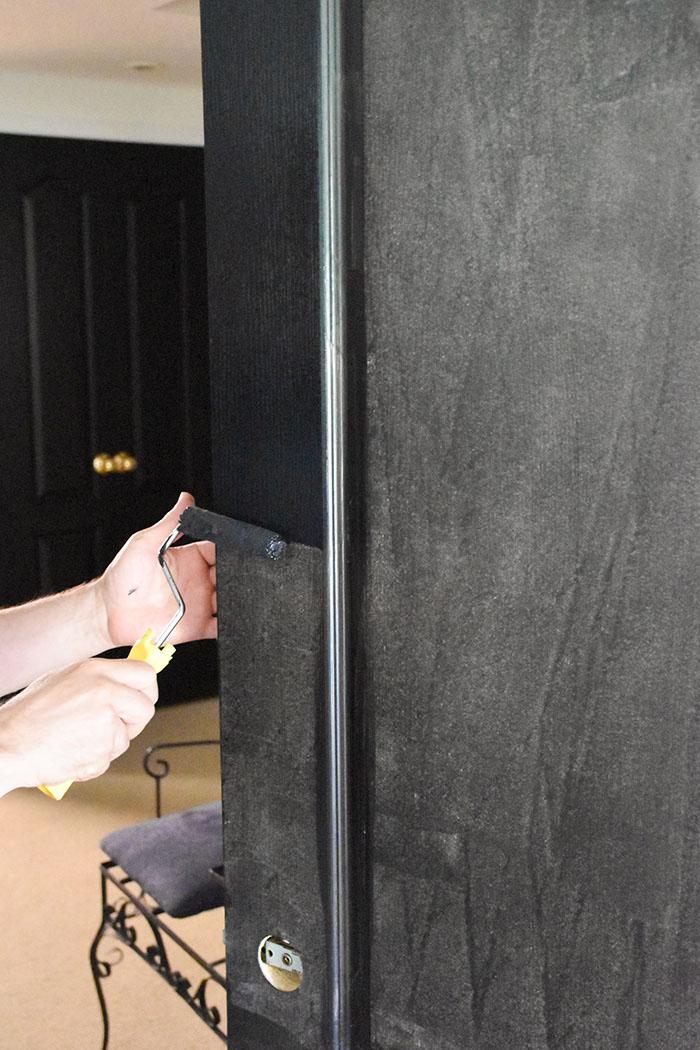 rolling-on-second-coat-of-coal-black-fusion-mineral-paint-interior-door